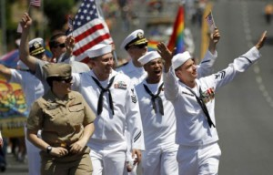 Service members march in uniform in last year's San Diego pride parade.